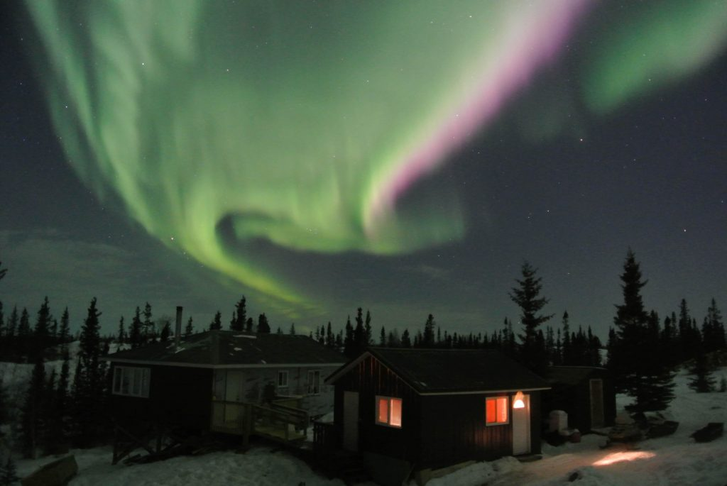 Beautiful aurora over lodge