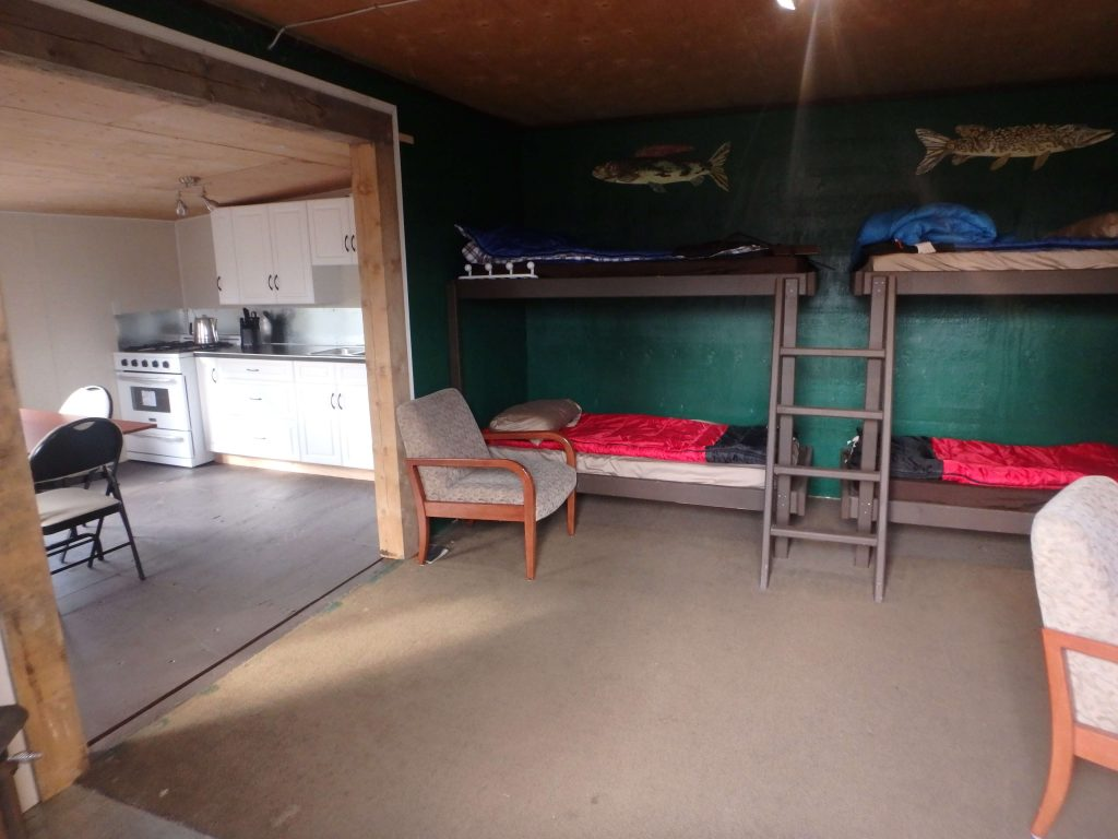 Interior of cabin with bunks and kitchen