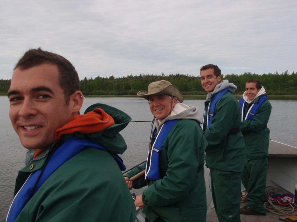 Group of guests fishing from boat on Great Slave Lake